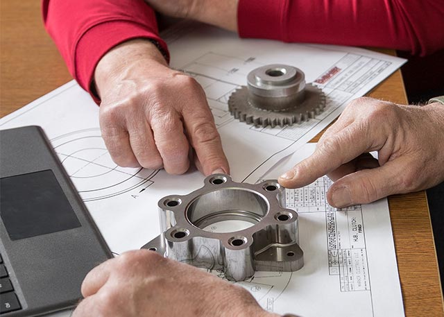 Engineers reviewing engineering drawings