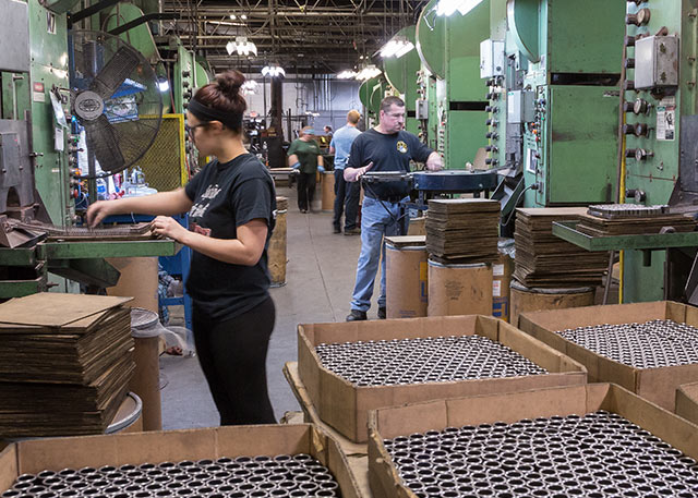 Employees working on manufacturing floor at Embassy Powdered Metals